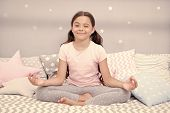 Meditate Before Go To Bed. Girl Child Sit On Bed In Her Bedroom. Kid Prepare To Go To Bed. Pleasant  poster