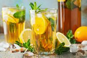 Traditional Iced Tea With Lemon And Ice In Tall Glasses On A Wooden Rustic Table poster