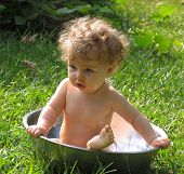 pic of baby toddler  - Baby outdoors in a basin of water - JPG