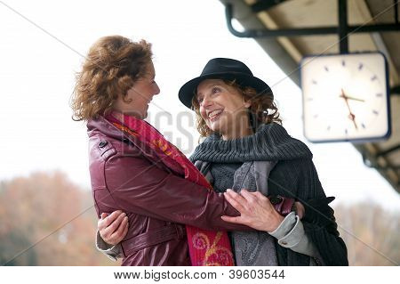 Friendly Hug At Train Station