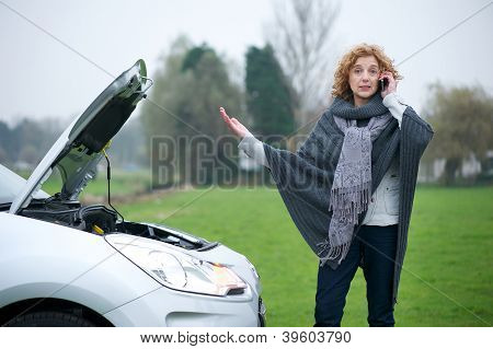 Woman Stressed with Broken Down Car