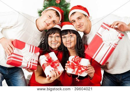 Two happy  family couples with gift boxes