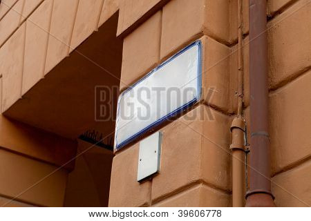 Ceramic Street Sign On Old House Wall