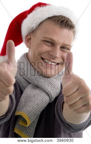 Male With Christmas Hat Showing Thumb Up With Both Hands