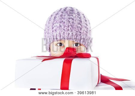 Boy Behind Christmas Gifts Isolated In White
