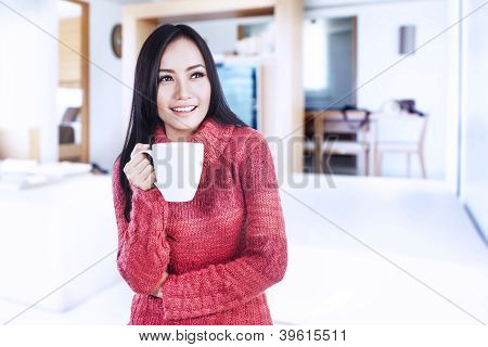 Smiling Winter Woman Holding Hot Coffee