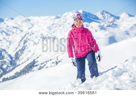 Young man with skis and a ski wear