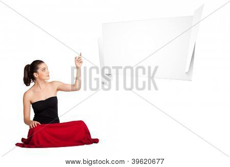 Beutiful young woman presenting abstract origami copy space isolated on white
