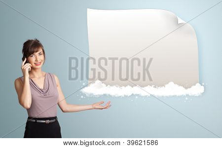 pretty young woman making phone call and presenting modern copy space on clouds