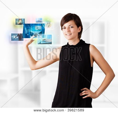 Young business woman browsing pictures on modern tablet