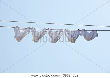 White Underpants Hanging To Dry