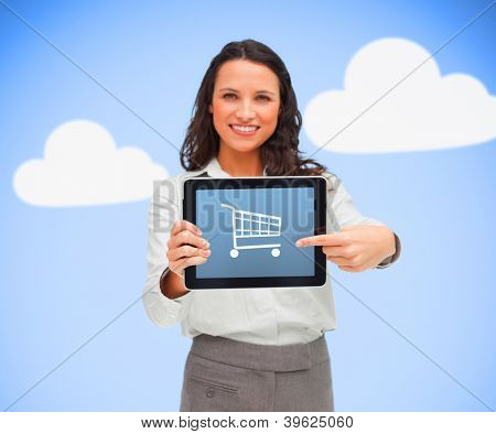 Businesswoman holding a tablet computer showing shopping app symbol against blue background while smiling