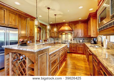 Luxury Wood Kitchen With Granite Countertop.