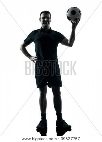 one man soccer player holding ball in studio silhouette isolated on white background