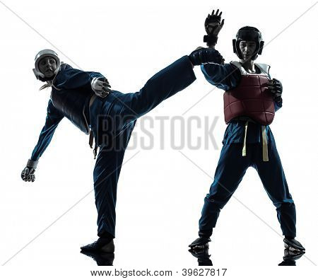 one causasian man exercising martial arts in silhouette studio isolated on white background