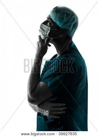 one caucasian doctor surgeon man portrait with face mask medical worker silhouette isolated on white background