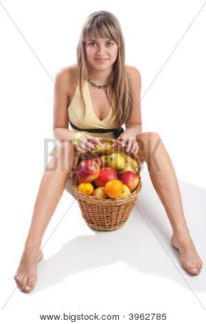 Young Lady Sitting With Fruit Basket