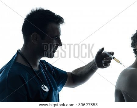 one caucasian man doctor surgeon medical worker holding hypodermic syringe  silhouette isolated on white background