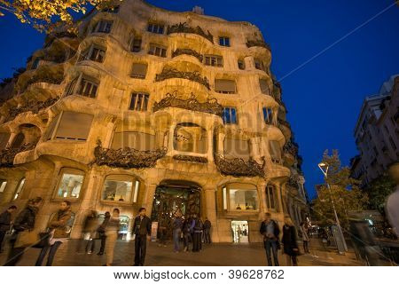 BARCELONA - NOVEMBER 24: Antonio Gaudi's famous Casa Mila, also known as La Pedrera , with people in front,  on November 24, 2012 in Barcelona, Spain