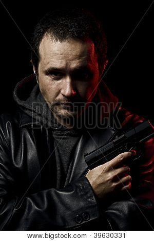 Gangster, man with a gun ready to shoot