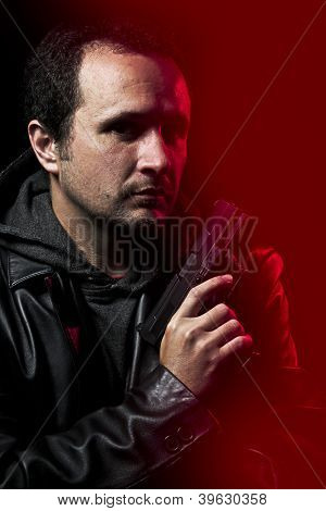 Robber with gun over red background