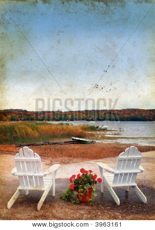 Adirondack Chairs By The Sea On Grunge Background