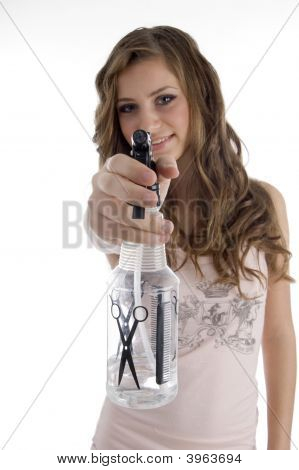 Smiling Young Beautician Showing Spray Bottle