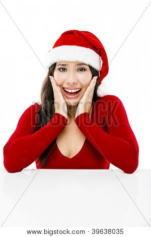 Beautiful asian woman with a astonished expression and wearing Santa's hat,  isolated on white