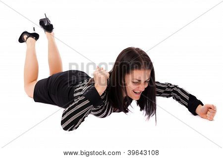Angry Businesswoman Hitting The Floor With Fists