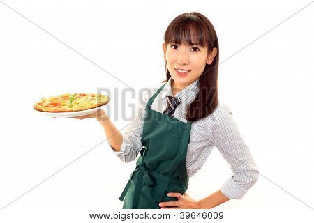 Smiling waitress carrying a meal