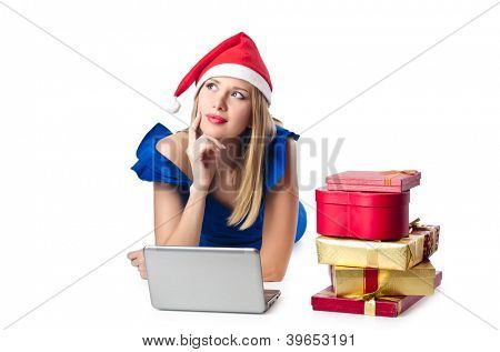 Santa woman with laptop on white