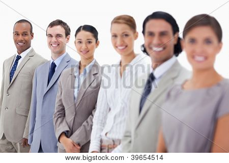 Close-up of happy business people looking straight with focus on the last three people