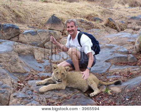 Petting a seven month old lion cub at the Lion Encounter education facility in Victoria Falls Zimbab
