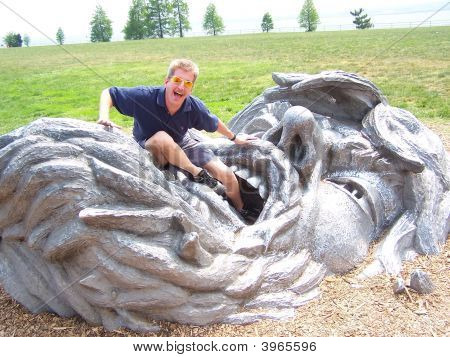 "Being eaten by ""The Awakening"" sculpture located at Hains Point in East Potomac Park in the Washingt"