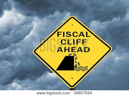 Fiscal cliff warning sign on stormy background