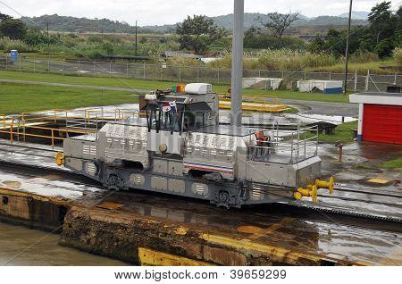 Trains (mules) side Panama Canal