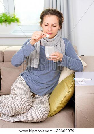 Ill Woman Taking Aspirin Pills.Headache. Pain.Sick Woman.Flu.Woman Caught Cold. Sneezing into Tissue. Headache. Virus .Medicines
