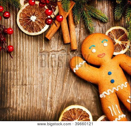 Christmas Holiday Background.Gingerbread Man over Wood.