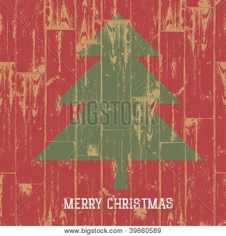 Christmas tree symbol and greetings on wooden planks texture. Raster version, vector file available in portfolio.