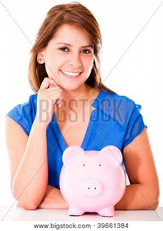 Happy woman with a piggybank - isolated over a white background