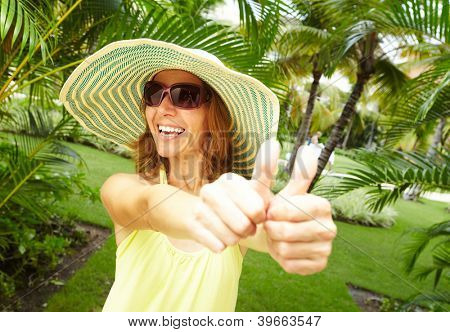 Happy woman in the tropical garden. Vacation.