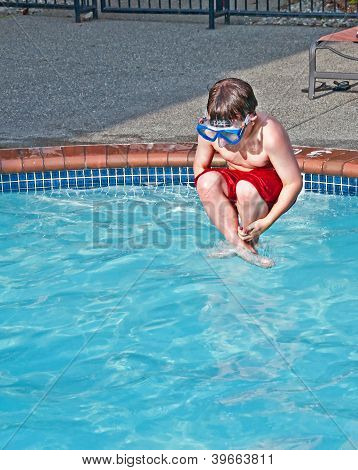 Caucasian Boy Doing Cannon Ball In Pool