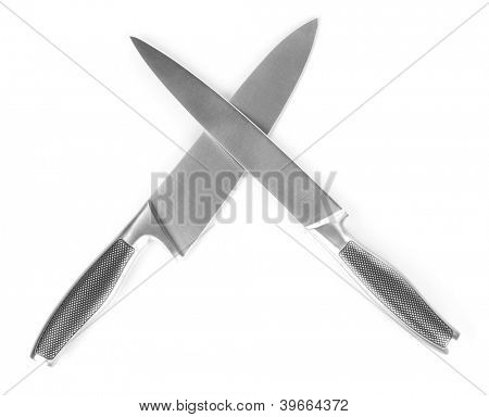Carving and utility knives crossed, isolated on white