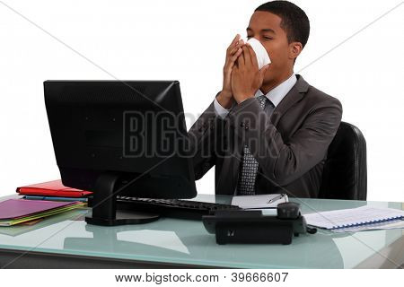 Executive rubbing his nose