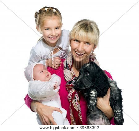 Pretty young woman with her daughters and dog on a white background