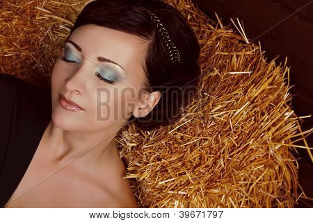 Close Up Make Up Of Beautiful Woman Slipping On Wheat Hay