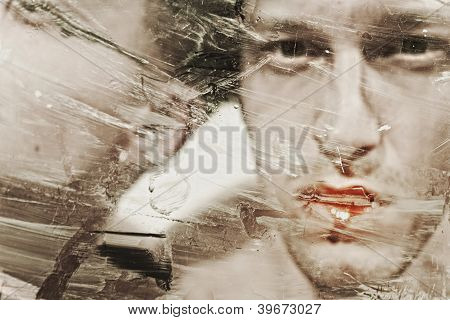 Beautiful Man's Face At A Dirty Muddy Glass Closeup