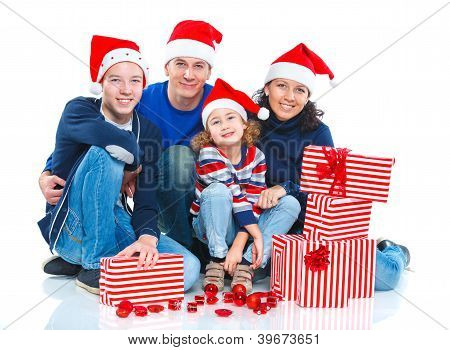 Family in Santa's hat with gift box