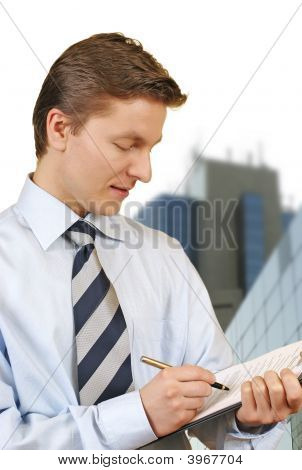 Business Man Holding A Clipboard With Corporate Buildings