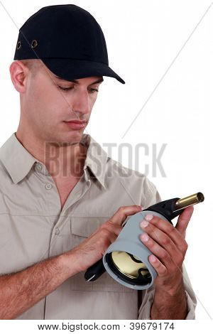 Man holding a blowtorch